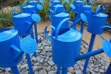 Blue Watering Cans Stock Images