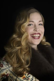 Smiling Woman In A Fur Collared Jacket Stock Image