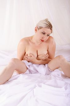 Blond In The Bed Royalty Free Stock Photography