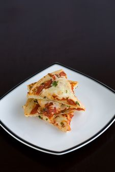Free Pizza Slices Stacked On A Plate Stock Photos - 2001253