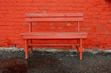 Red Bench And Brick Wall Royalty Free Stock Photo