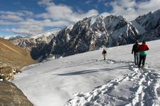 Free Men, Mountains And Glacier. Royalty Free Stock Images - 2007109