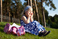Free Merry Beautiful Girl Sitting On Green Grass Stock Images - 20004894