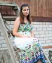 Free Young Girl Sits On A Wooden Ladder Royalty Free Stock Photos - 20007468
