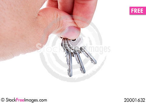 Three silver keys in a hand Stock Photo