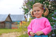 Free Smiling Girl In Pink Coat Royalty Free Stock Photos - 20005678