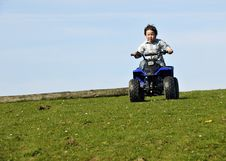 Boy Driving ATV Royalty Free Stock Image