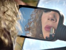 Free Girl With Lipstick And Mirror Of Car Royalty Free Stock Images - 20008389