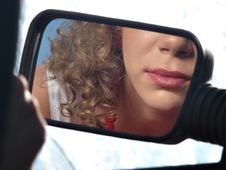 Free Girl With Lipstick And Mirror Of Car Stock Image - 20008411
