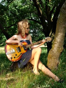 Girl On The Picnic With Guitar Stock Photography