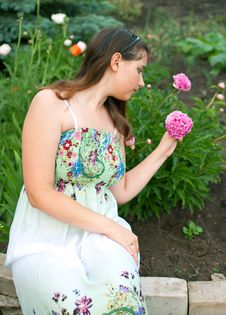 Free Girl Against Pink Peony Flowers Royalty Free Stock Photography - 20008737