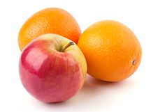 Free Two Oranges And Juicy Apple Royalty Free Stock Photography - 20009617