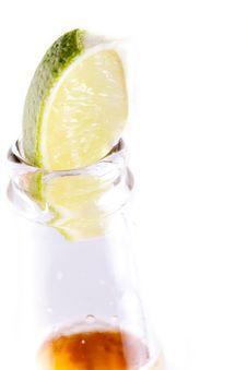 Free Beer Bottle With Lime Wedge Royalty Free Stock Photos - 20009688