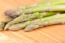 Asparagus On The Wooden Board Stock Images