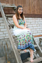 Free Girl Sits On A Wooden Ladder Royalty Free Stock Photos - 20019108