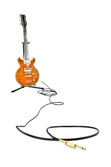 Orange Electric Guitar And Cord Isolated On White