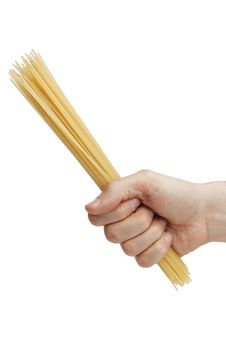 Free Man S Hand Holding A Handful Of Spaghetti. Royalty Free Stock Photography - 20013337