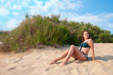 Free Woman In Swimsuit On The Sand Stock Photo - 20013350
