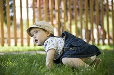 Free Baby Girl Outdoors In The Grass Royalty Free Stock Photos - 20013398