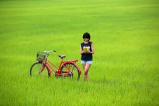 Free Beautiful Girl Reading A Book With Bike In Paddy Stock Photos - 20013803
