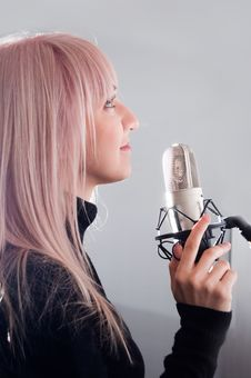 Free Blonde Girl At The Microphone Royalty Free Stock Photo - 20014565