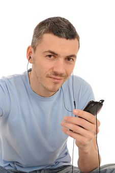 Free Casual Man With Cell Phone And Headphones Stock Photography - 20014812