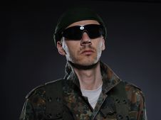 Soldier In Camouflage And Ammunition Stock Images