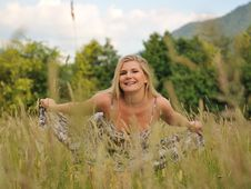 Pretty Summer Woman On Field Royalty Free Stock Photo