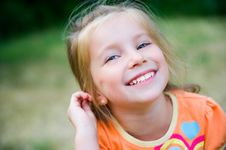 Free Cute Little Girl  On The Meadow Stock Image - 20015531