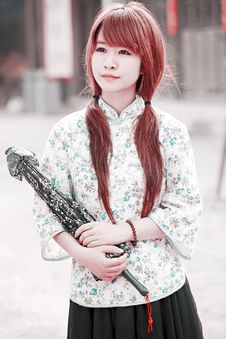 Chinese Girl In Traditional Dress Royalty Free Stock Photography