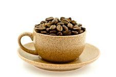 A Coffee Cup Full Of Coffee Beans Royalty Free Stock Photography