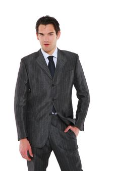 Businessman Standing With Hand In Pocket Stock Photo
