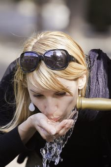 Free Lady Drinking Tap Water Royalty Free Stock Photography - 20025457
