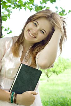 Free Teenager Girl With Book Royalty Free Stock Image - 20025676