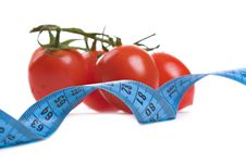 Tomatoes And  Measure Tape Stock Image