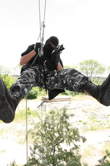 Soldier In Black Mask On Rope With Ak-47 Stock Photography