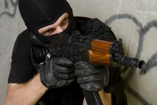 Soldier In Black Mask Targeting With AK-47 Rifle Stock Photography