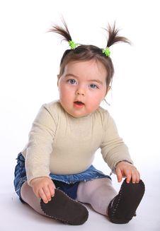 Small Baby Looking At The Camera Royalty Free Stock Photo