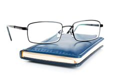 Free Blue Notebook And Glasses Stock Photos - 20028363