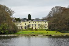 English Style: Expensive Luxury Home On Lake Stock Photo