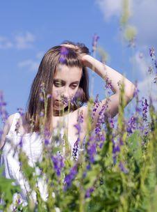 Girl Walking In A Meadow Stock Photo