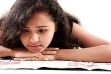 Indian Female Reading Newspaper Royalty Free Stock Photo