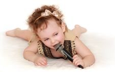 Free Girl With A Microphone Lies Royalty Free Stock Photos - 20029488