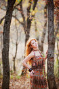 Free The Red-haired Girl In Autumn Leaves Stock Photo - 20030260