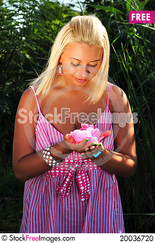 Free Young Beautiful Blonde Girl With Flower Stock Photo - 20036720