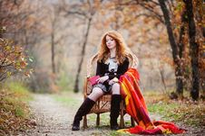 Free The Red-haired Girl In Autumn Leaves Stock Photo - 20030230