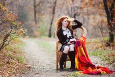 Free The Red-haired Girl In Autumn Leaves Stock Photography - 20030232