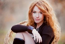 Free The Red-haired Girl In Autumn Leaves Stock Image - 20030241