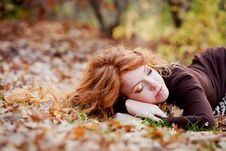 Free The Red-haired Girl In Autumn Leaves Royalty Free Stock Images - 20030249