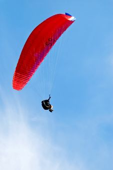 Free Red Paraglider Flying In Blue Sky Royalty Free Stock Image - 20031336